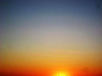 sun setting horizon
